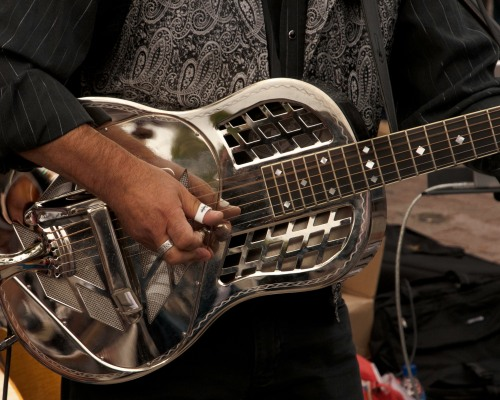 close-up of steel-faced guitar