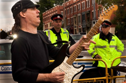 back-up guitar with police in background