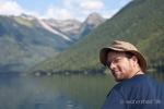 happy canoer on mountain valley lake